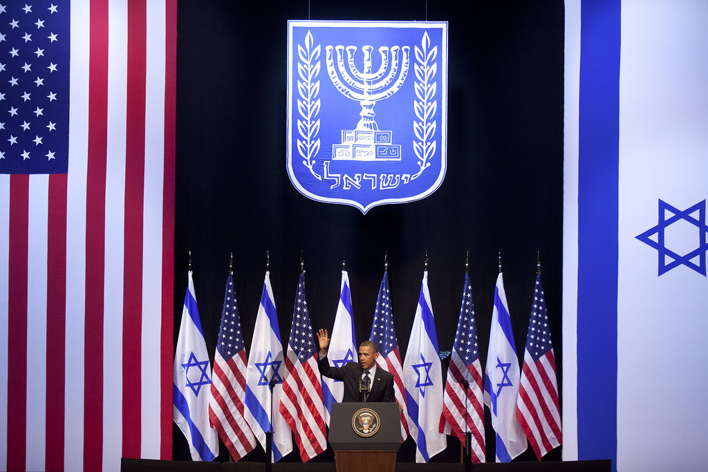 Description of . U.S. President Barack Obama waves at the end of his speech to Israeli students on March 21, 2013 in Jerusalem, Israel.   (Photo by Uriel Sinai/Getty Images)