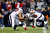 J.J. Watt #99 and Brooks Reed #58 of the Houston Texans sack Tom Brady #12 of the New England Patriots during the 2013 AFC Divisional Playoffs game at Gillette Stadium on January 13, 2013 in Foxboro, Massachusetts.  (Photo by Jim Rogash/Getty Images)