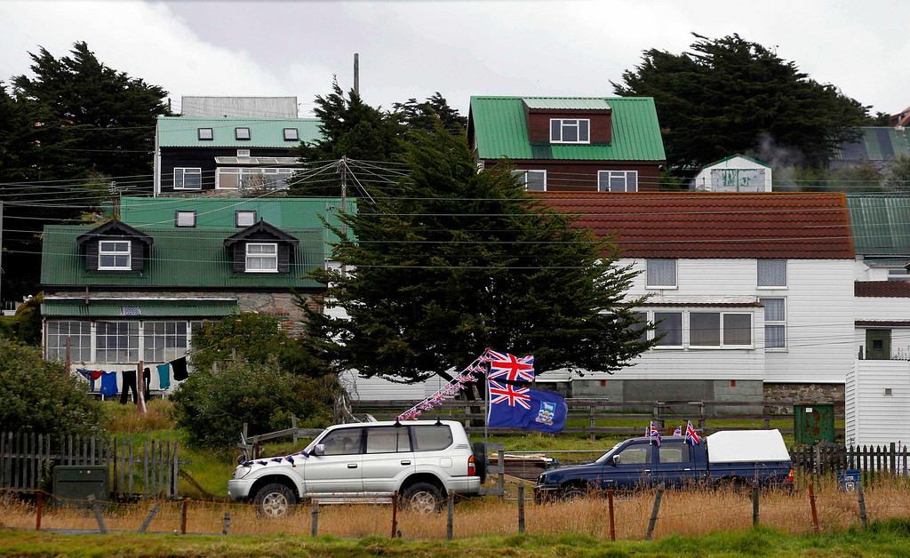 Description of . A vehicle decorated with a Falkland Islands flag and the Union Jack passes by in Stanley, March 11, 2013. Residents of the Falkland Islands started voting on Sunday and continue today in a sovereignty referendum that seeks to counter Argentina's increasingly assertive claim over the British-ruled territory.  REUTERS/Marcos Brindicci