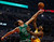 Chicago Bulls' Joakim Noah (L) blocks a shot by Denver Nuggets' Kenneth Faried during the first half of their NBA basketball game in Chicago, Illinois March 18, 2013.   REUTERS/Jim Young
