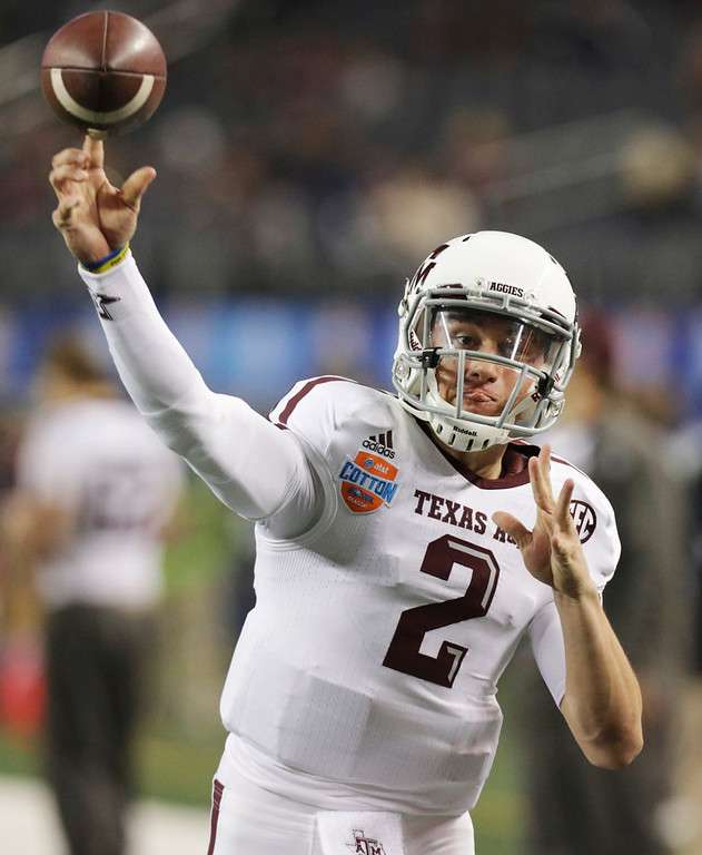 Description of . Texas A&M quarterback Johnny Manziel warms up before the Cotton Bowl NCAA college football game against Oklahoma at Cowboys Stadium on Friday, Jan. 4, 2013, in Irving, Texas. (AP Photo/LM Otero)