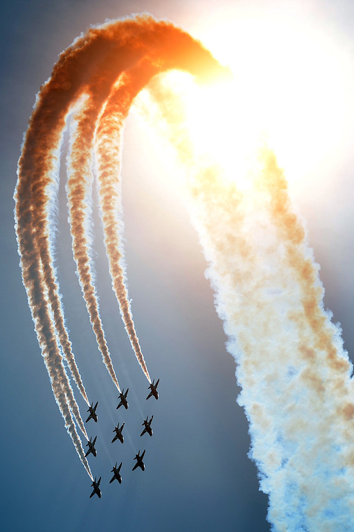 Description of . Britain's Red Arrows airplane display team perform during D-Day commemorations in Portsmouth in southern England on June 5, 2014. Several hundred surviving veterans of the 1944 D-Day landings are commemorating the 70th anniversary of the mission on both sides of the English channel.  AFP PHOTO / CARL COURT/AFP/Getty Images