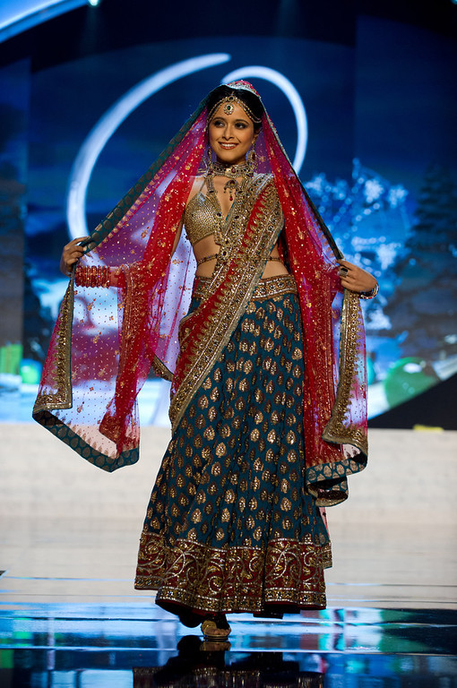 Description of . Miss India 2012, Shilpa Singh, performs onstage at the 2012 Miss Universe National Costume Show on Friday, Dec. 14, 2012 at PH Live in Las Vegas, Nevada. The 89 Miss Universe Contestants will compete for the Diamond Nexus Crown on Dec. 19, 2012. (AP Photo/Miss Universe Organization L.P., LLLP)