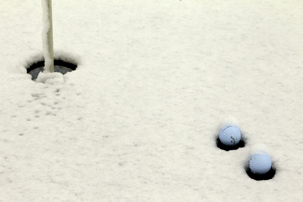 Description of . MARANA, AZ - FEBRUARY 20:  Golf balls are seen in the snow on the practice putting green as play was suspended due to weather during the first round of the World Golf Championships - Accenture Match Play at the Golf Club at Dove Mountain on February 20, 2013 in Marana, Arizona.  (Photo by Jed Jacobsohn/Getty Images)