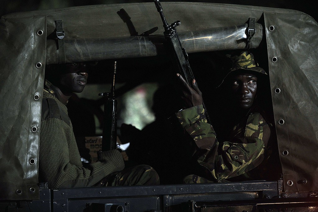 Description of . Kenyan paramilitaries drive towards the Westgate mall on September 24, 2013 in Nairobi. Kenyan President Uhuru Kenyatta announced today that the four-day siege by Islamist gunmen of a Nairobi shopping mall was over, with the