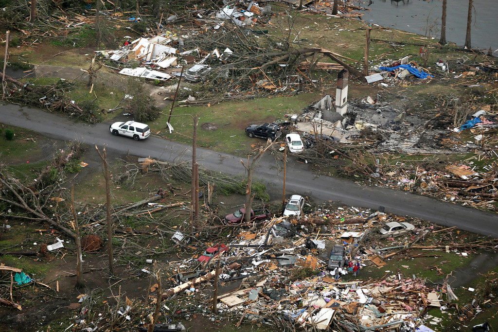 Description of . A Highway Police car patrols a neighborhood in Mayflower, Ark., Monday, April 28, 2014, after a tornado struck the town late Sunday, killing at least 17 people.   (AP Photo/Danny Johnston)