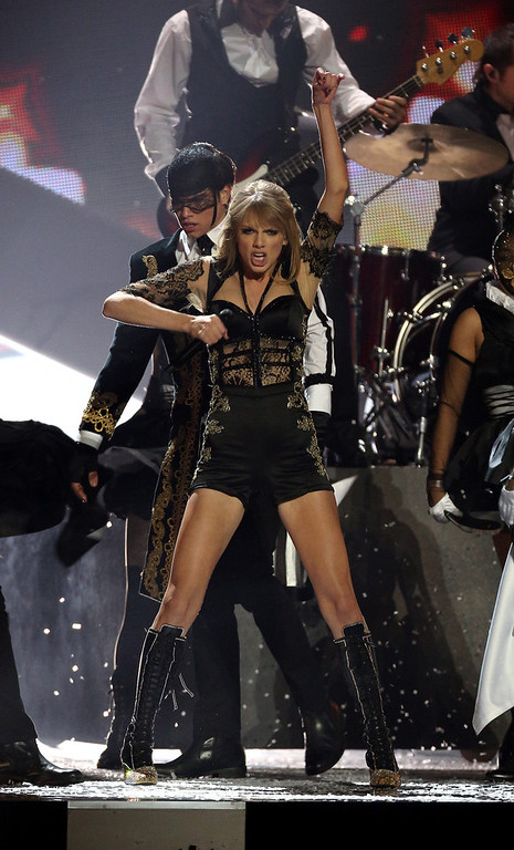 Description of . Taylor Swift performs on stage during the BRIT Awards 2013 at the o2 Arena in London on Wednesday, Feb. 20, 2013. (Photo by Joel Ryan/Invision/AP)