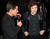 Actor Mario Lopez (L) interviews Harry Styles of the band One Direction as he arrives for Fox's