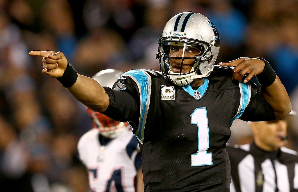 . Cam Newton #1 of the Carolina Panthers reacts after running for a first down against the New England Patriots during their game at Bank of America Stadium on November 18, 2013 in Charlotte, North Carolina.  (Photo by Streeter Lecka/Getty Images)