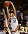 Colorado's Arielle Roberson (32) shoots over Wyoming's Kaitlyn Mileto, left, and Chaundra Sewell (33) during their NCAA college basketball game, Wednesday, Nov. 28, 2012, in Boulder, Colo. Colorado won 68-59. (AP Photo/The Daily Camera, Jeremy Papasso)
