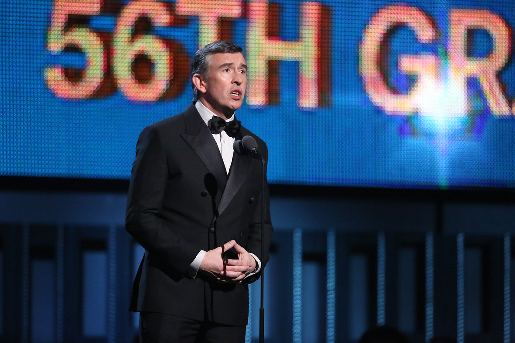 Description of . Steve Coogan speaks on stage at the 56th annual Grammy Awards at Staples Center on Sunday, Jan. 26, 2014, in Los Angeles. (Photo by Matt Sayles/Invision/AP)