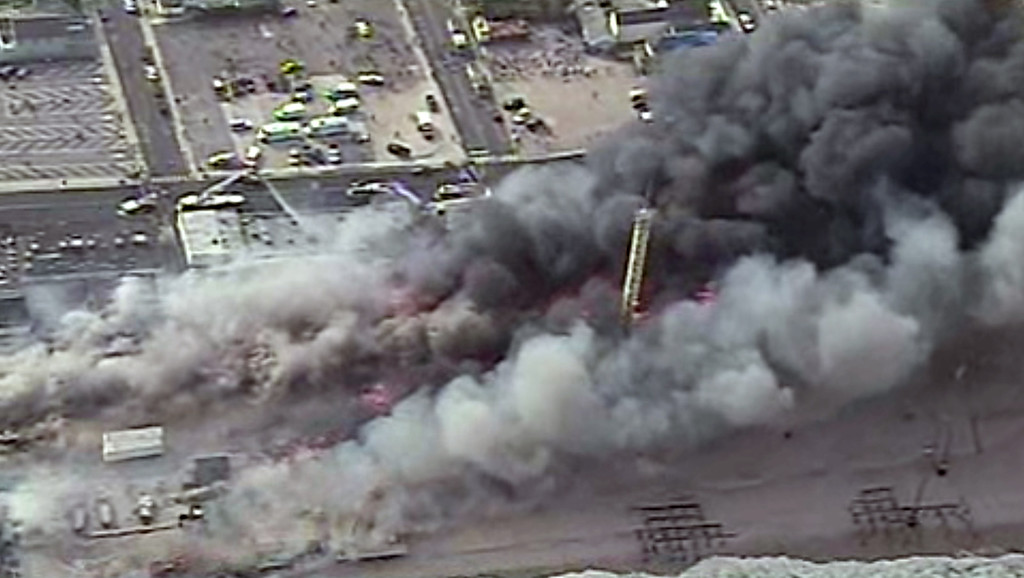 Description of . A fire rages in Seaside Park, N.J. on Thursday, Sept. 12, 2013. The fire began in a frozen custard stand on the Seaside Park section of the boardwalk and quickly spread north into neighboring Seaside Heights. (AP Photo/ABC)