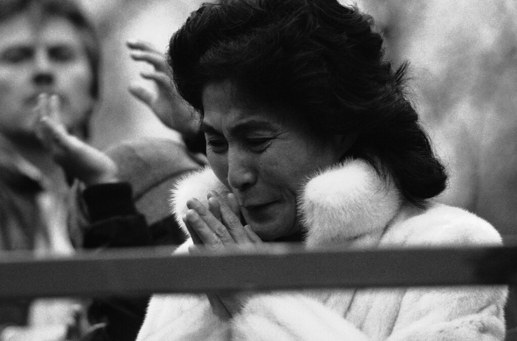 Description of . Yoko Ono, widow of John Lennon, reacts during ceremonies in New Yorks Central Park, dedicating a portion of the park as Strawberry Fields after the title of one of the ex-Beatles songs, Wednesday, March 21, 1984, New York. (AP Photo/Rene Perez)