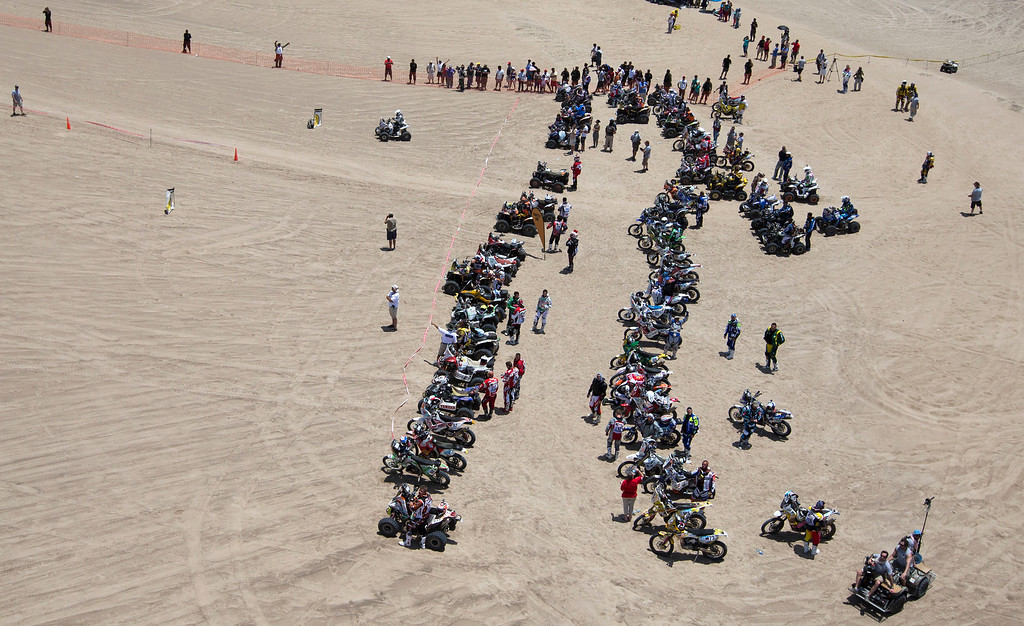 Description of . Competitors line up their quads and motorcycles for the start of the 1st stage of the 2013 Dakar Rally near Pisco, Peru, Saturday, Jan. 5, 2013. The race finishes in Santiago, Chile, on Jan. 20. (AP Photo/Victor R. Caivano)