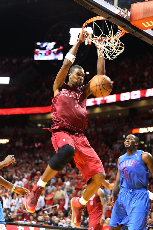 Description of . MIAMI, FL - DECEMBER 25: Chris Bosh #1 of the Miami Heat dunks against the Oklahoma City Thunder at AmericanAirlines Arena on December 25, 2012 in Miami, Florida. The Heat defeated the Thunder 103-97.  (Photo by Marc Serota/Getty Images)
