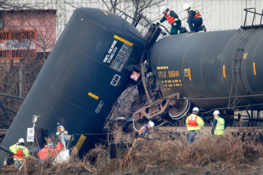 . Workers investigate a train derailment in Paulsboro, N.J. on Friday, Nov. 30, 2012 that is leaking hazardous material into a creek and causing a leak of hazardous gas that was blamed for sickening dozens of people, authorities said. ( AP Photo/Philadelphia Daily News, Alejandro A. Alvarez)