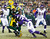Green Bay Packers running back DuJuan Harris (26) tries to break a tackle by Minnesota Vikings strong safety Jamarca Sanford (33) during a touchdown run in the first half of an NFL wild card playoff football game Saturday, Jan. 5, 2013, in Green Bay, Wis. (AP Photo/Jeffrey Phelps)
