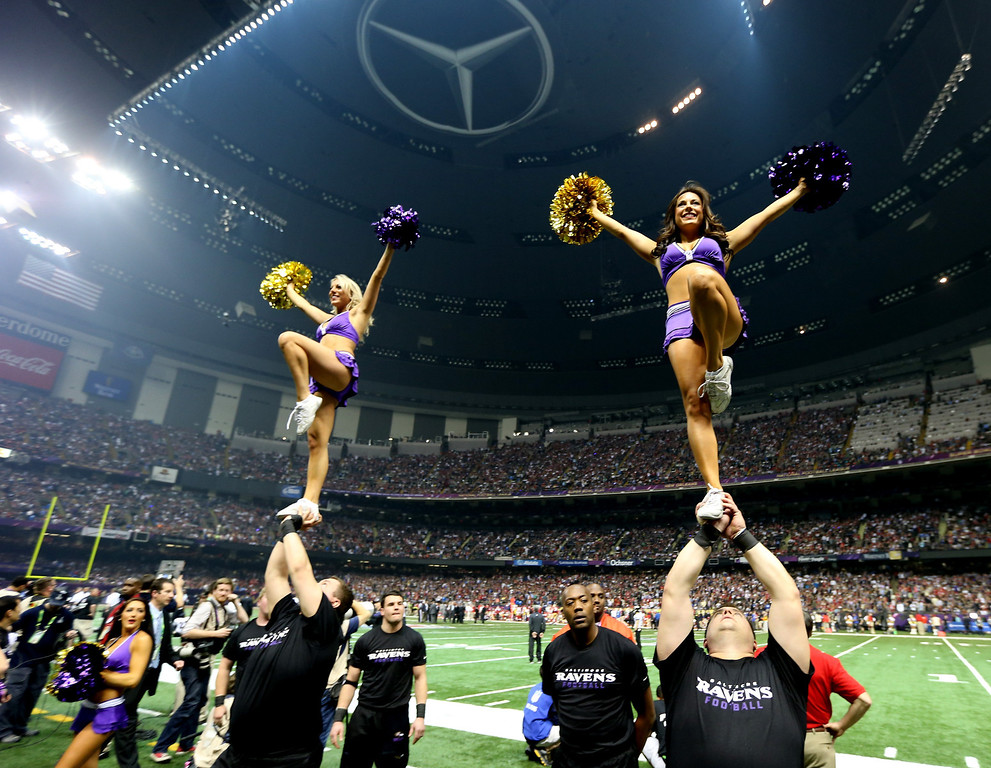 Description of . Baltimore Ravens cheerleaders perform during a power outage that occurred in the third quarter and caused a 34-minute delay during Super Bowl XLVII between the Baltimore Ravens and the San Francisco 49ers at the Mercedes-Benz Superdome on February 3, 2013 in New Orleans, Louisiana.  (Photo by Chris Graythen/Getty Images)