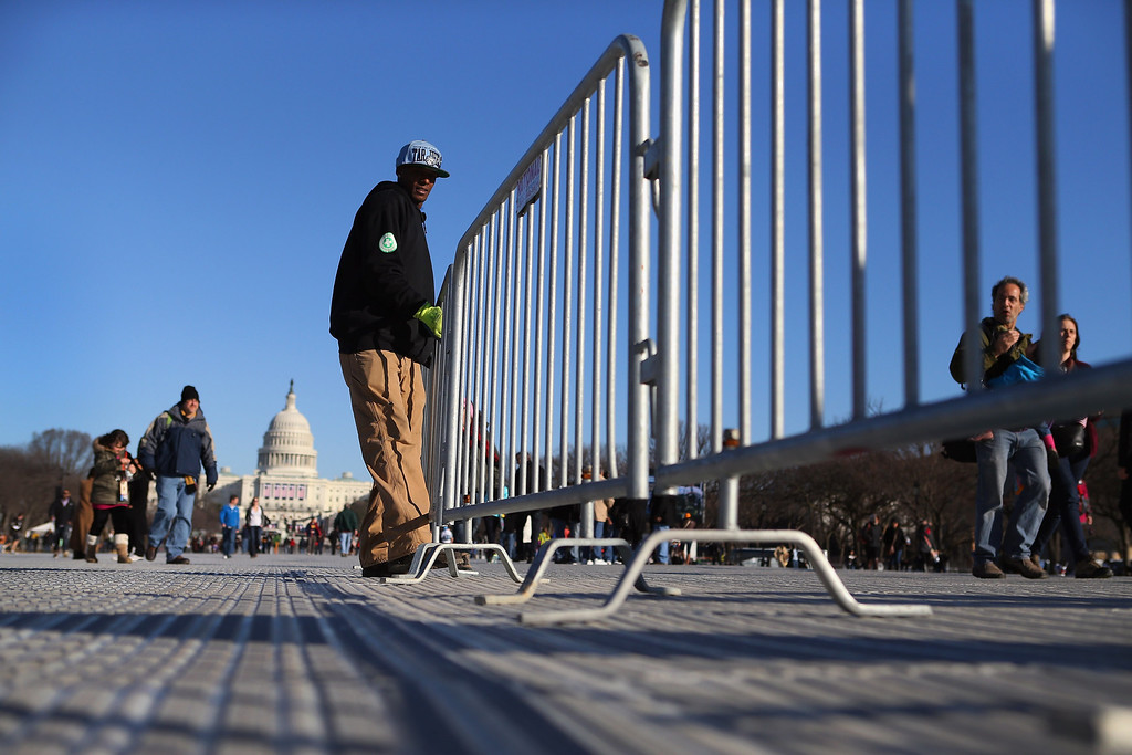 Description of . Alvin Martin places barriers in place on the National Mall as preparations continue for the Inauguration ceremony on January 20, 2013 in Washington, DC. The U.S. capital is preparing for the second inauguration of U.S. President Barack Obama, which will take place on January 21.  (Photo by Joe Raedle/Getty Images)