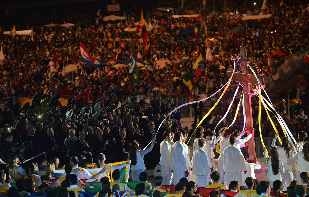 Description of . The World Youth Day (WYD) Cross that in 1984 Pope John Paul II entrusted the youth of the world is fixed on the stage before the arrival of Pope Francis for a prayer vigil with hundreds of thousands of young Catholic pilgrims attending WYD, at Copacabana beach in Rio de Janeiro, Brazil, on July 27, 2013.  LUCA ZENNARO/AFP/Getty Images