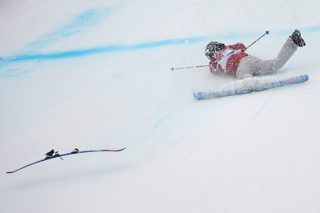 Description of . Canada\'s Kaya Turski wipes out during the women\'s ski slopestyle qualifier. Sochi 2014 Winter Olympics on Tuesday, February 11, 2014. (Photo by AAron Ontiveroz/The Denver Post)