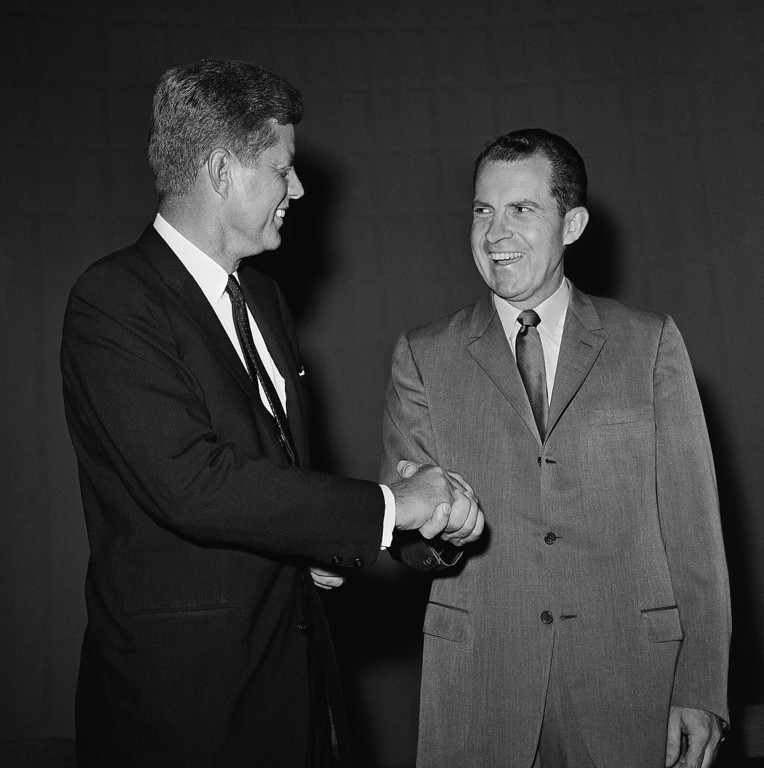 . Presidential nominee Richard Nixon and Sen. John F. Kennedy shake hands, Sept. 26, 1960, in Chicago, as they met for a televised debate.   Associated Press file