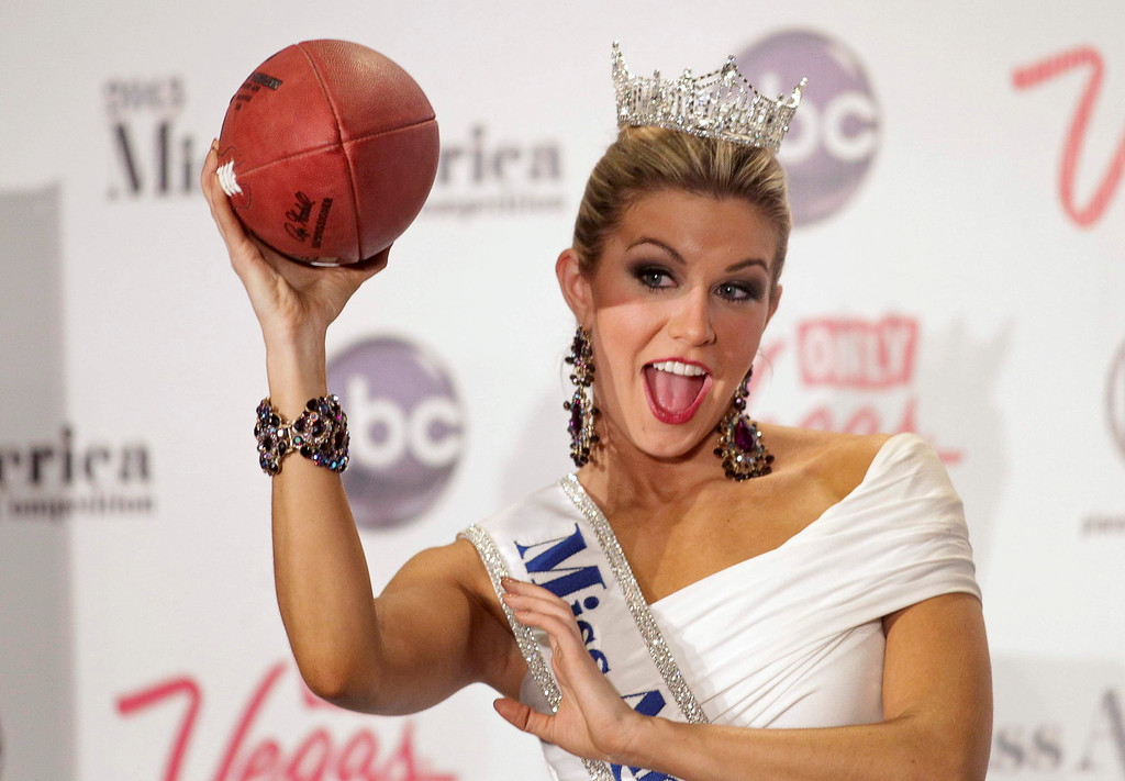 Description of . Miss America 2013 Mallory Hytes Hagan, 23, Miss New York, poses with a football during a news conference after winning the Miss America Pageant in Las Vegas January 12, 2013. REUTERS/Steve Marcus