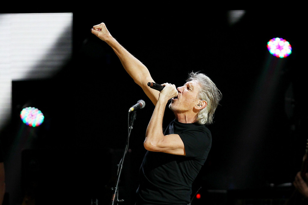 Description of . This image released by Starpix shows Roger Waters performing at the 12-12-12 The Concert for Sandy Relief at Madison Square Garden in New York on Wednesday, Dec. 12, 2012. Proceeds from the show will be distributed through the Robin Hood Foundation. (AP Photo/Starpix, Dave Allocca)