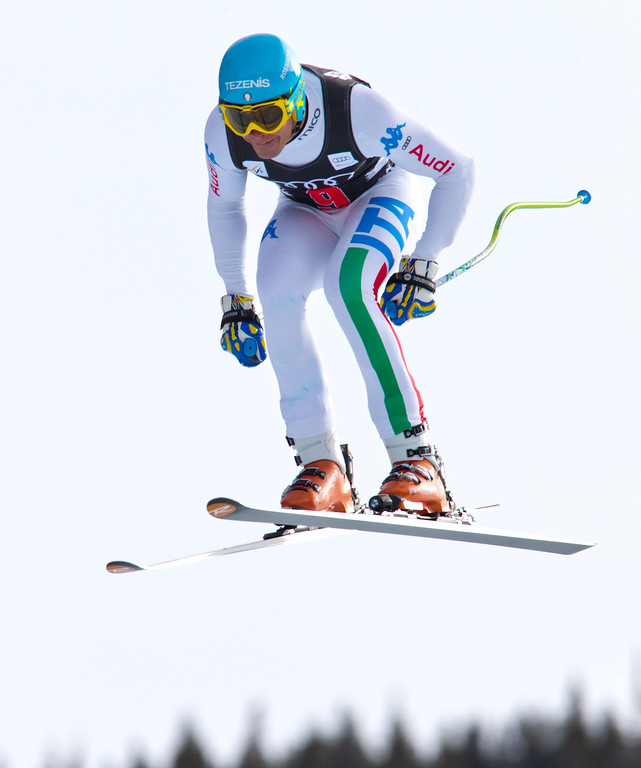 Description of . Christof Innerhofer, of Italy, goes airborne during the men's World Cup downhill ski race, Friday, Nov. 30, 2012, in Beaver Creek, Colo. Innerhofer placed first. (AP Photo/Nathan Bilow)