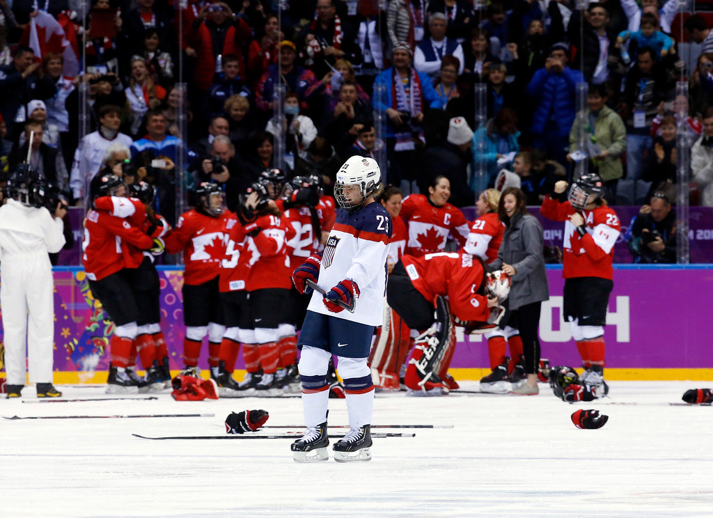 Description of . Michelle Picard of the United States (23) skates back to the bench after Canada scored in overtime to win the women's gold medal ice hockey game 3-2 at the 2014 Winter Olympics, Thursday, Feb. 20, 2014, in Sochi, Russia. (AP Photo/Matt Slocum)