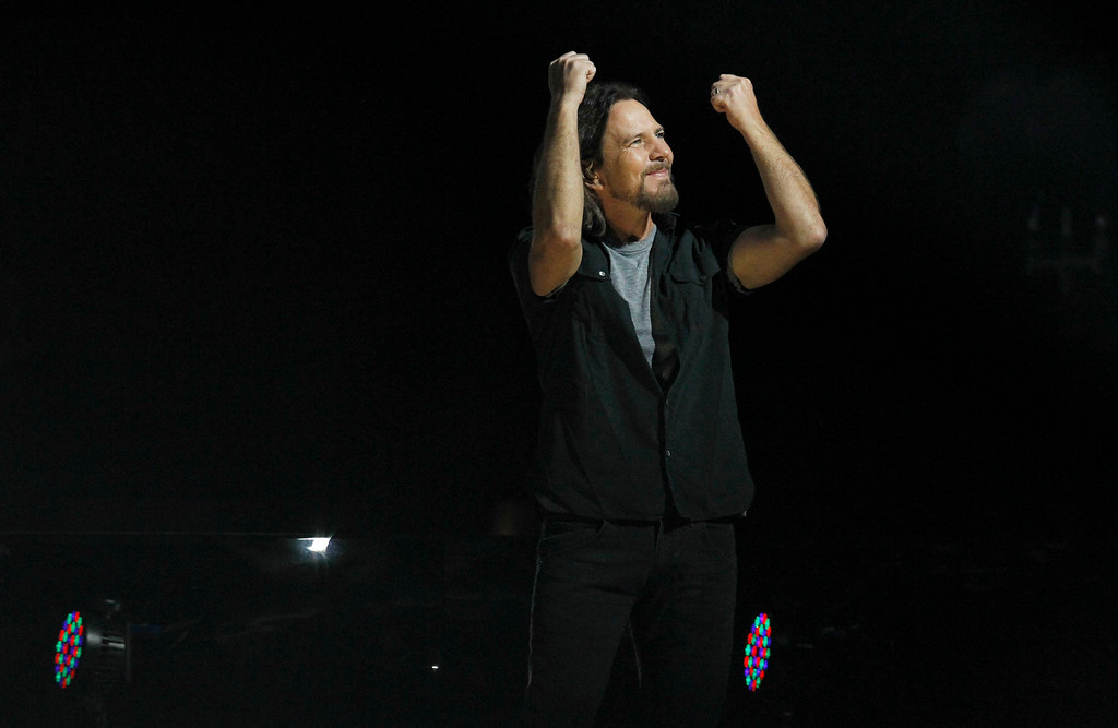 Description of . Eddie Vedder performs with Roger Waters (not pictured) during the