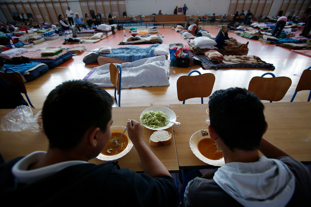 Description of . Bosnian people evacuated from her flooded home takes shelter at a sports center in the northern Bosnian town of Odzak 240 kms north of Sarajevo, on Monday May 19, 2014.  (AP Photo/Amel Emric)