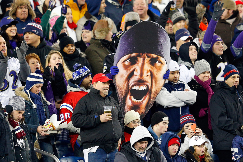Description of . A fan holds up a giant photo of the face of Ray Lewis #52 of the Baltimore Ravens during the 2013 AFC Championship game at Gillette Stadium on January 20, 2013 in Foxboro, Massachusetts.  (Photo by Jim Rogash/Getty Images)