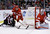 Colorado Avalanche right wing Aaron Palushaj (17) and Detroit Red Wings defenseman Brian Lashoff (23) reach for the puck behind Detroit goalie Jimmy Howard (35) during the first period of an NHL hockey game in Detroit, Tuesday, March 5, 2013. (AP Photo/Carlos Osorio)