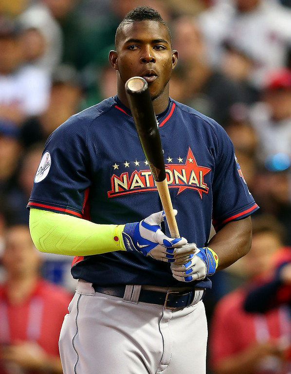 Description of . National League All-Star Yasiel Puig #66 of the Los Angeles Dodgers bats during the Gillette Home Run Derby at Target Field on July 14, 2014 in Minneapolis, Minnesota.  (Photo by Elsa/Getty Images)