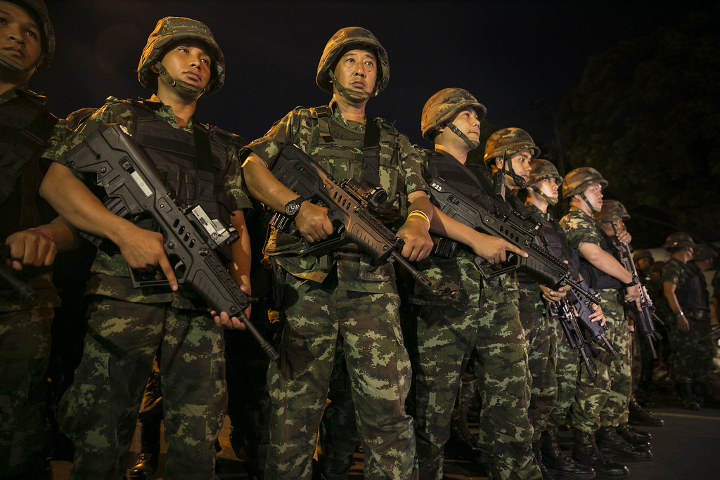 Description of . Thai military take over the streets asserting control after an anti-coup protest  May 23, 2014 in Bangkok, Thailand. The Army chief announced yesterday that the armed forces were seizing power in a non-violent coup.  (Photo by Paula Bronstein/Getty Images)