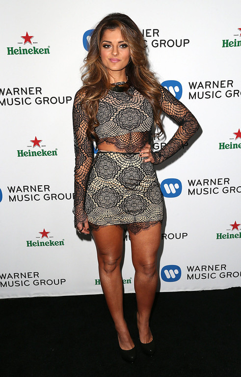 Description of . Recording artist Bebe Rexha attends Warner Music Group Hosts Annual Grammy Celebration at the Sunset Tower Hotel on January 26, 2014 in West Hollywood, California.  (Photo by Frederick M. Brown/Getty Images)