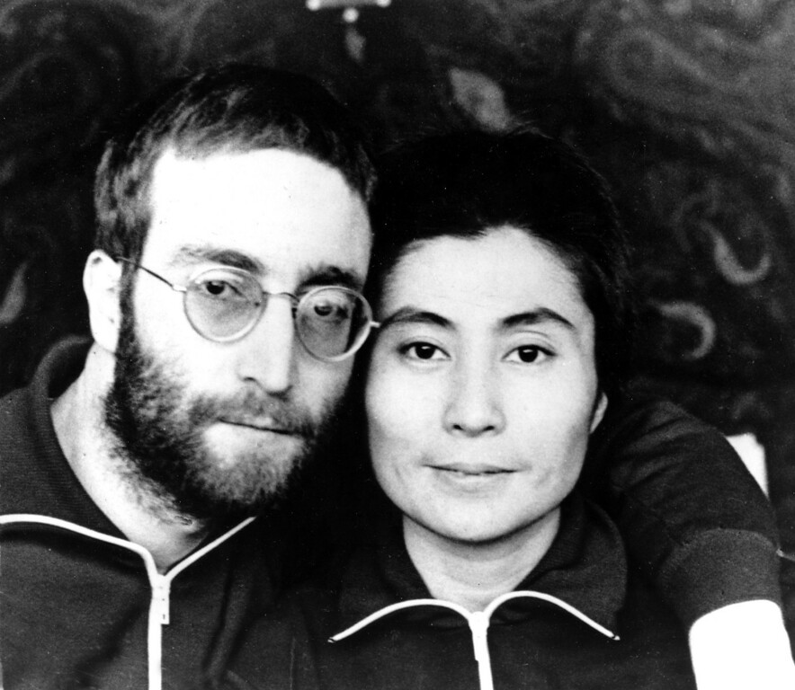 Description of . Beatle John Lennon and his wife, Yoko Ono, pose in short hair at their farmhouse retreat in North Jutland, Denmark, Jan. 23, 1970.  (AP Photo)