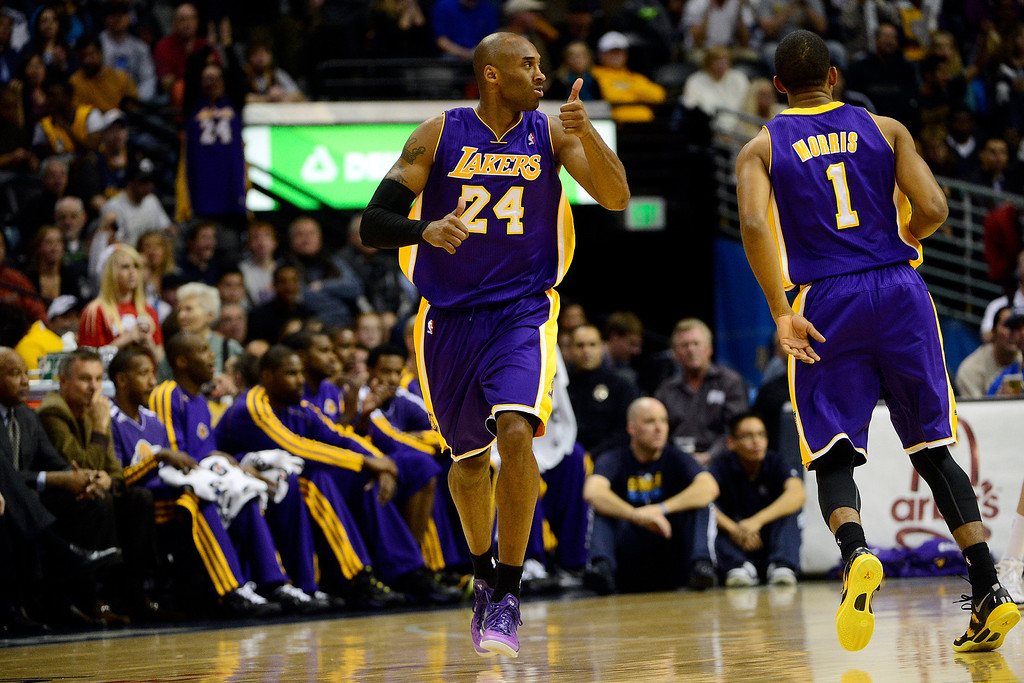 Description of . Los Angeles Lakers shooting guard Kobe Bryant (24) gives a thumbs up to point guard Steve Nash (10) after an assist against the Denver Nuggets during the first half at the Pepsi Center on Wednesday, December 26, 2012. AAron Ontiveroz, The Denver Post