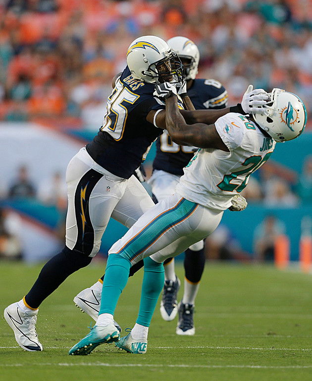 Description of . Miami Dolphins free safety Reshad Jones (20) attempts to bring down San Diego Chargers tight end Antonio Gates (85) during the first half of an NFL football game, Sunday, Nov. 17, 2013, in Miami Gardens, Fla. (AP Photo/Wilfredo Lee)