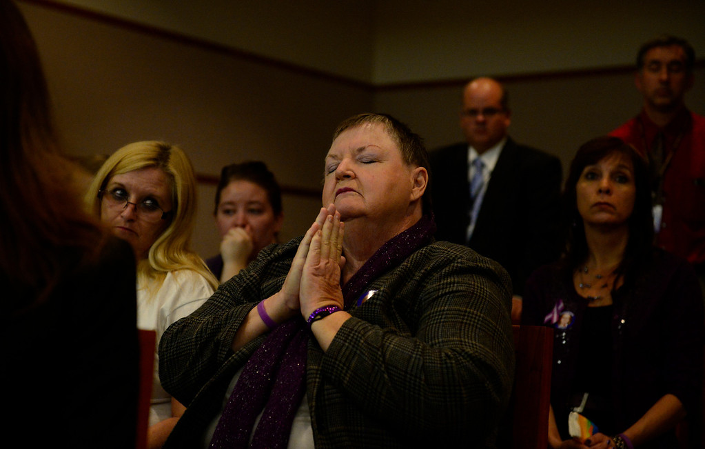 Description of . Donna Moss, Jessica Ridgeway's great grandmother, prays during a news conference in district court in Golden, November 19, 2013. The news conference was held in the courtroom where District Judge Stephen Munsinger had just sentenced 18-year-old Austin Sigg to life plus 86 years for Jessica Ridgeway's murder. (Photo by RJ Sangosti/The Denver Post)