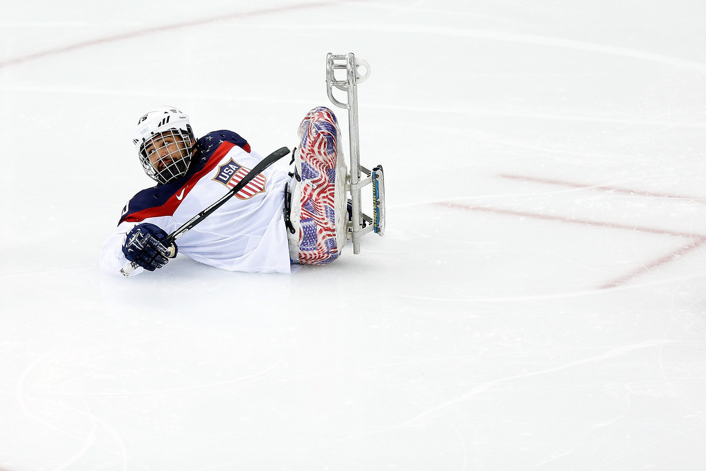 Description of . Nikko Landeros of USA takes a tumble during the Ice Sledge Hockey Preliminary Round Group B match between the USA and Korea at Shayba Arena on March 9, 2014 in Sochi, Russia.  (Photo by Harry Engels/Getty Images)