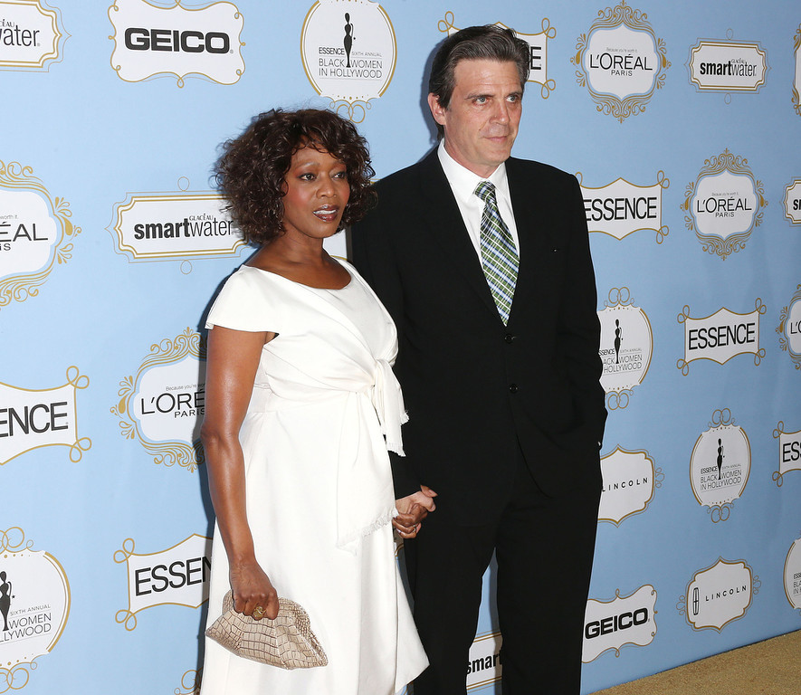 Description of . Actress Alfre Woodard (L) and Roderick Spencer attend the Sixth Annual ESSENCE Black Women In Hollywood Awards Luncheon at the Beverly Hills Hotel on February 21, 2013 in Beverly Hills, California.  (Photo by Frederick M. Brown/Getty Images)