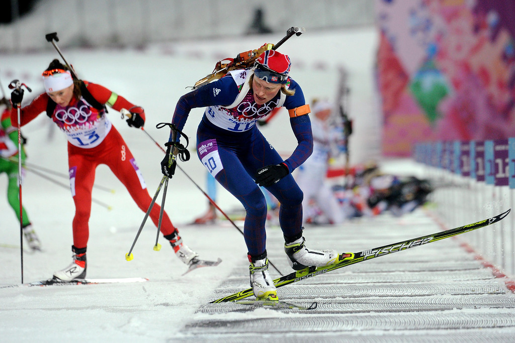 Description of . Norway\'s Tora Berger competes in the Women\'s Biathlon 10 km Pursuit at the Laura Cross-Country Ski and Biathlon Center during the Sochi Winter Olympics on February 11, 2014 in Rosa Khutor near Sochi .   KIRILL KUDRYAVTSEV/AFP/Getty Images