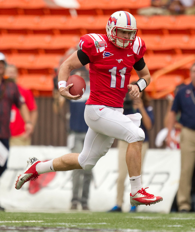 Description of . SMU quarterback Garrett Gilbert breaks free on a quarterback sneak against Fresno State in the first quarter of the Hawaii Bowl NCAA college football game Monday, Dec. 24, 2012, in Honolulu. (AP Photo/Eugene Tanner)
