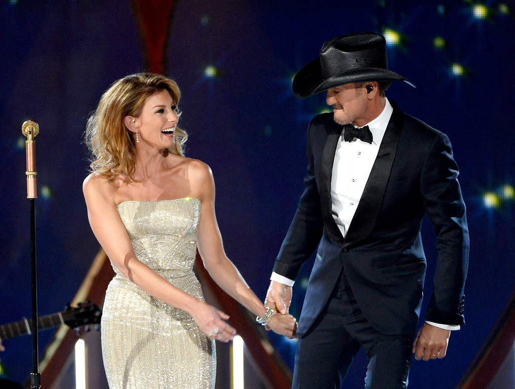 Description of . Singers Faith Hill (L) and Tim McGraw perform onstage during the 49th Annual Academy Of Country Music Awards at the MGM Grand Garden Arena on April 6, 2014 in Las Vegas, Nevada.  (Photo by Ethan Miller/Getty Images)