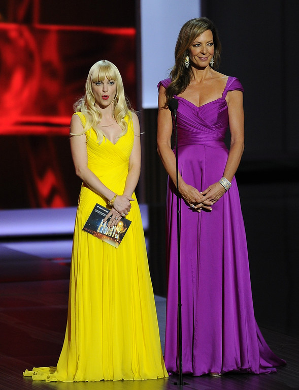 Description of . Anna Faris, wearing Monique Lhuiller, left, and Allison Janney, wearing David Meister Signature, present the award for outstanding writing for a miniseries, movie or a dramatic special at the 65th Primetime Emmy Awards at Nokia Theatre on Sunday Sept. 22, 2013, in Los Angeles.  (Photo by Chris Pizzello/Invision/AP)