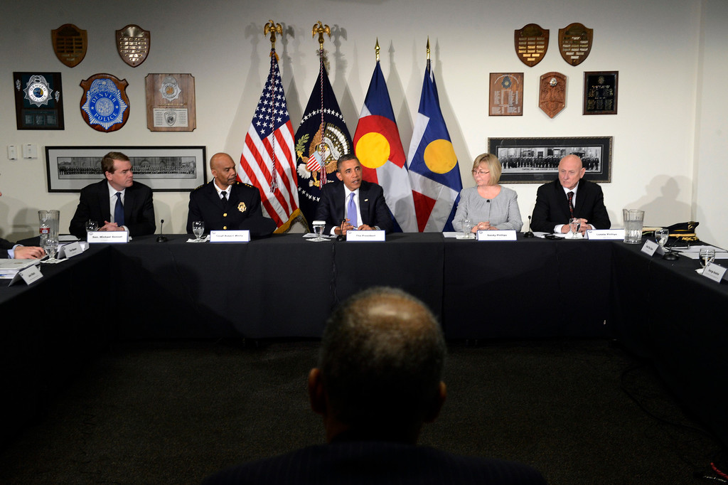 Description of . DENVER, CO. - APRIL 03: President Barack Obama, center is joined by (l-r) Senator Michael Bennet, Denver Police Chief, Robert White and Sandy and Lonnie Phillips during a round table discussion at the Denver Police Academy in Denver, CO April 03, 2013. The meeting took place before a forum with law enforcement officials and community leaders.   (Photo By Craig F. Walker/The Denver Post)