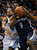 Memphis Grizzlies forward Tony Allen (9) drives past Denver Nuggets center Andre Iguodala (back) in the third quarter of their NBA basketball game in Denver December 14, 2012.   REUTERS/Rick Wilking