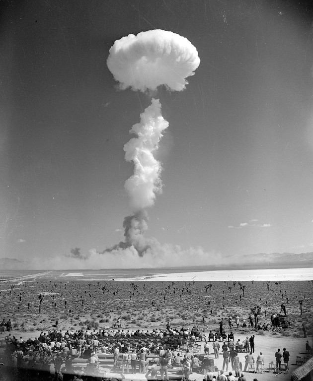 Description of . The mushroom cloud of an atomic bomb rises above Nevada's Yucca Flat April 22, 1952. Some 1,500 civilian observers, news people, ground soldiers and paratroopers in the air witnessed the blast. (AP Photo)